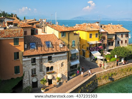 View of colorful old building in Sirmione and Lake Garda from Scaliger castle wall, Italy - stock photo