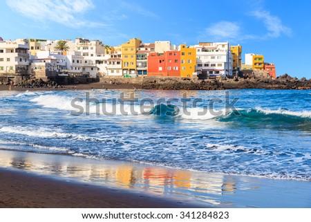 View of colourful houses of Punta Brava from beach in Puerto de la Cruz, Tenerife, Canary Islands, Spain - stock photo