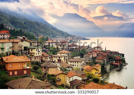 View of Como Lake, Milan, Italy, on sunset with Alps mountains in background - stock photo