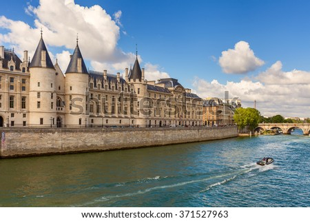 View of Conciergerie - former prison and part of former royal palace on the bank of Seine river in Paris, France. - stock photo