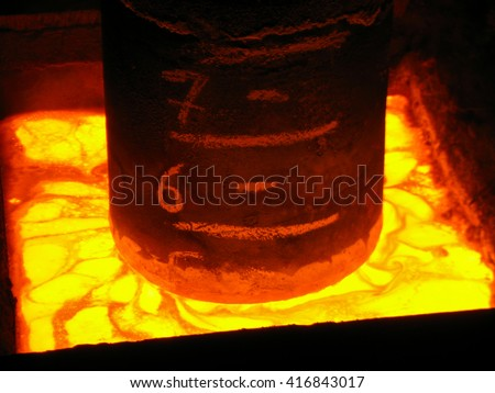 View of consumable steel electrode into molten slag bath during Electroslag Remelting - Special Metallurgy process, that used for remelting and refining of high-alloyed steels and super-alloys. - stock photo