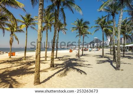 View of Copacabana beach behind the  palms in Rio de Janeiro, Brazil - stock photo