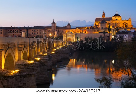 View of Cordoba with Roman bridge and  Mosque-cathedral in evening. Andalusia, Spain - stock photo