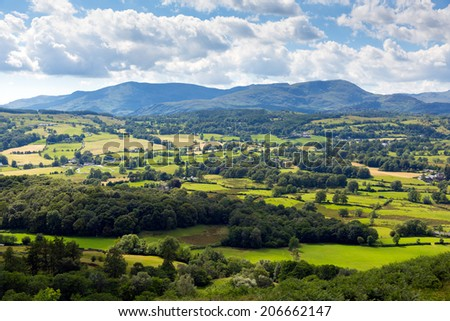 View of countryside in the Lake District National Park England uk on a beautiful sunny summer day near Hawkshead popular tourist village known for William Wordsworth and Beatrix Potter - stock photo