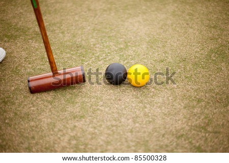 View of Croquet mallet and balls in action - stock photo