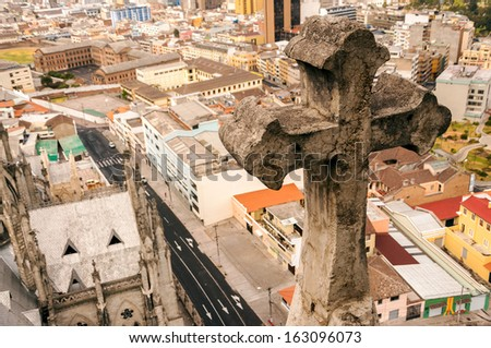 View of cross from Quito basilica with city in the background in Ecuador - stock photo