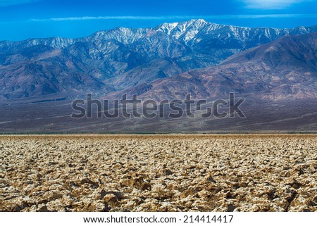 View of Death Valley and the surrounding mountains from Devil's Golf Course. Death Valley National Park, California, USA. - stock photo