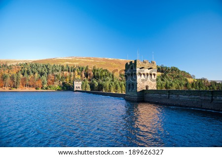 View of Derwent Dam and Reservoir, Peak District National Park, Derbyshire, UK. Derwent Reservoir is the middle of three reservoirs in the Upper Derwent Valley in the north-east of Derbyshire, England - stock photo