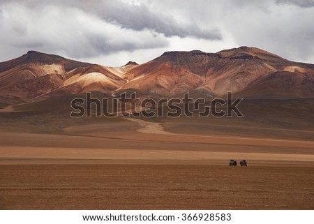view of distant andean mountains in bolivia salar de uyuni - stock photo