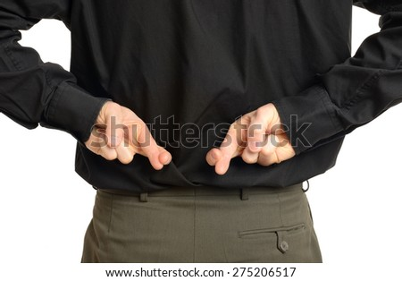 view of double crossed fingers behind back of man in a suit isolated on white - stock photo