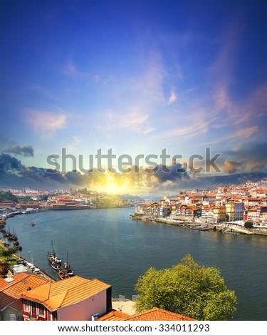 view of Douro riverside and the Dom Luiz bridge , Porto , Portugal. Colorful Travel background - stock photo