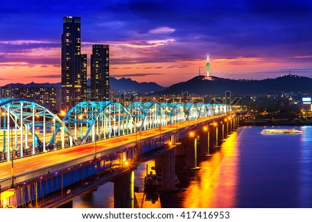 View of downtown cityscape at Dongjak Bridge and Seoul tower over Han river in Seoul, South Korea. - stock photo