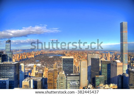 View of downtown Manhattan and Central Park with famous skyscrapers on a snowy day - HDR image - stock photo