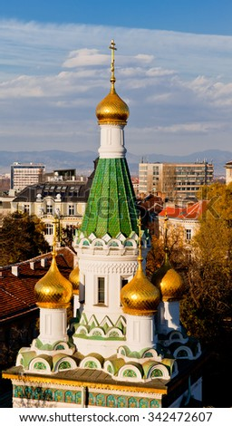 "View of downtown Sofia, yellow stone paved central bulevard ""Tsar Osvoboditel"" and the Sofia University ""St. Climent Ohridski"" at the back and a part of the Bulgarian Academy of sciance in the center. - stock photo"