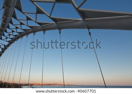 View of downtown Toronto at sunset from the Humber river bridge - stock photo