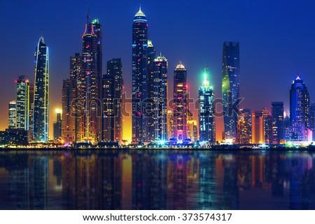 View of Dubai by night, UAE - stock photo