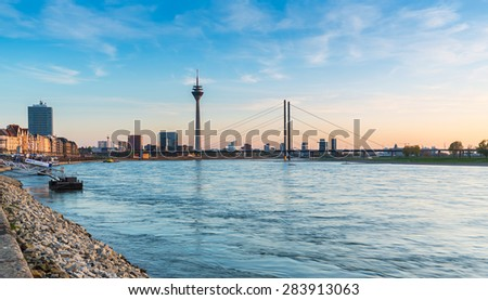 view of Dusseldorf at the rhine shore on sunset in germany - stock photo