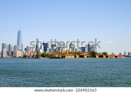 View of Ellis Island from across the Hudson River with Lower Manhattan, New York City, NY, USA in the background. - stock photo