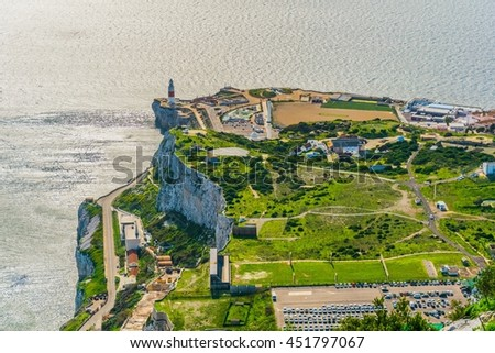 View of end of gibraltar with a lighthouse and a mosque - stock photo