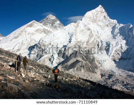 view of Everest and Nuptse from Kala Patthar with people - stock photo