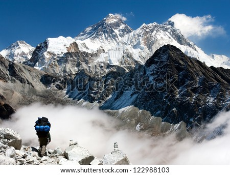view of Everest from Gokyo with tourist on the way to Everest - Nepal - stock photo