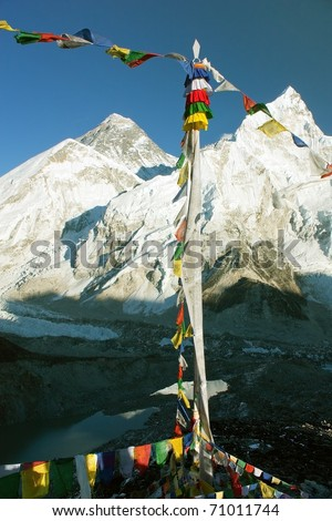 view of Everest with buddhist prayer flags from kala patthar - stock photo