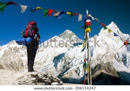 View of Everest with tourist and buddhist prayer flags from Kala Patthar and blue sky - way to Everest Base Camp - Nepal  - stock photo