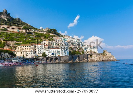 View of famous Amalfi town in the afternoon sunshine, on the coast of mediterranean sea in Italy - stock photo