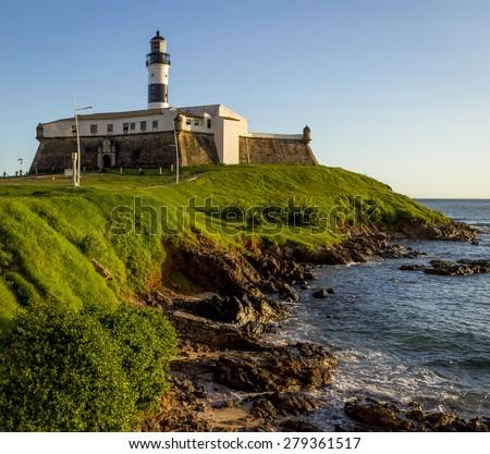 View of Farol da Barra lighthouse in Salvador, Bahia, Brazil on a sunny summer day. - stock photo
