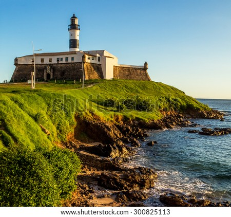 View of Farol da Barra lighthouse in Salvador, Bahia, Brazil on a sunny summer day. - stock photo