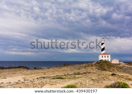 View of Favaritx lighthouse within Albufera des Grau Natural Park, Menorca,  Spain - stock photo
