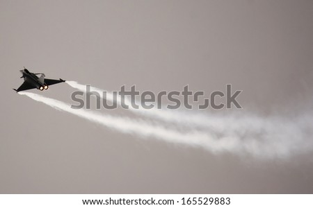 View of french fighter Dassalut Rafale zooming up in acrobatic flight - stock photo