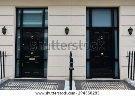 View of Front Doors of Neighbouring Georgian Era London Town Houses - stock photo