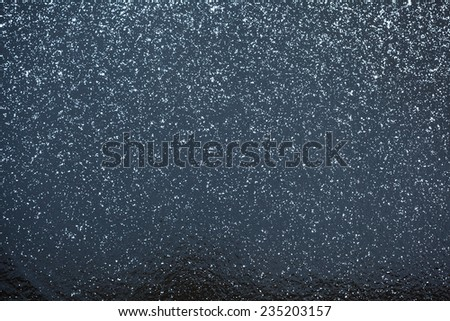 view of frozen lake in winter with some snow - stock photo