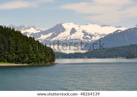 view of glacier from Alaskan ferry - stock photo