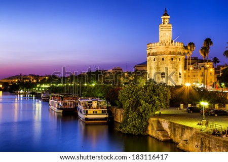 View of Golden Tower (Torre del Oro) of Seville, Andalusia, Spain over river Guadalquivir at sunset  - stock photo