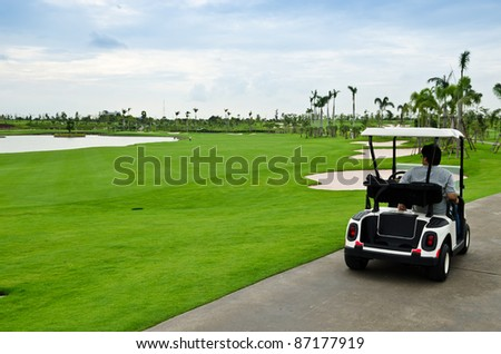 view of golf cart at golf course, Thailand - stock photo