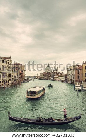 View of gondola and boats on Canal Grande at a cloudy day, Venice (Venezia), Italy, Europe, Vintage filtered style - stock photo