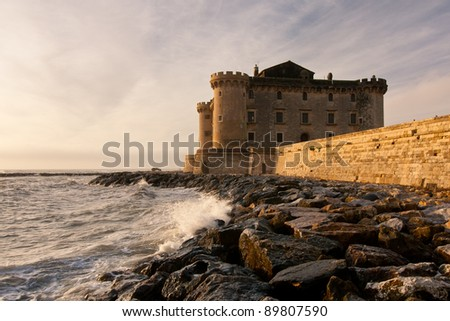 View of great Orsini castle of Palo, Italy at sunset - stock photo
