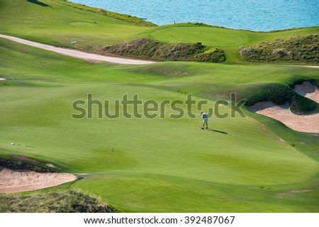 View of green golf resort field. summer vacations - stock photo