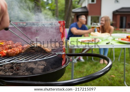 View of grilling meat on a barbecue - stock photo