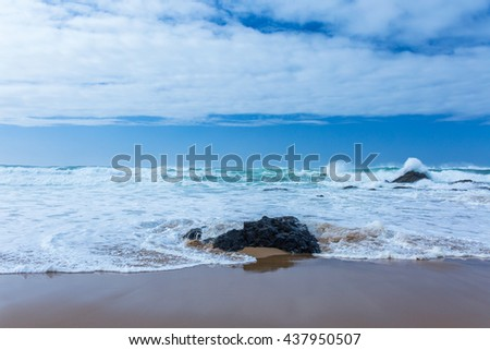 View of Guincho Beach, Cascais, Portugal. Empty beach. No people. Basalt rock. Beauty in nature. Waves on the Atlantic ocean. Beautiful marine landscape. - stock photo