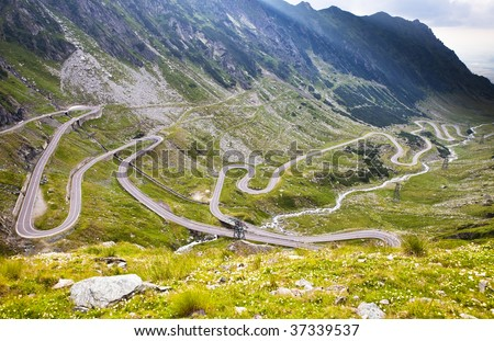 View of hairpin bend road in Fogaras mountains. Transfogarian Road in Romania. - stock photo