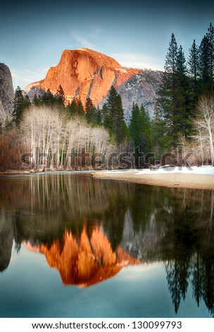 View of half dome at sunset reflected in the Merced River - stock photo