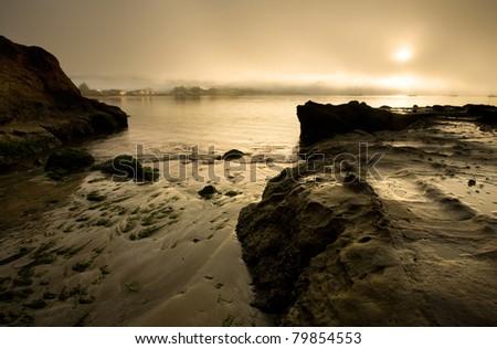View of Half Moon Bay at dawn, with sailboats - stock photo