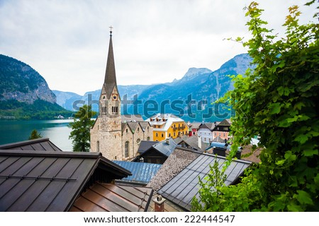 View of Hallstatt village with Christuskirche church bell tower on lake shore and Alps behind, Austria - stock photo