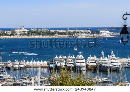 View of Harbor and marina with moored yachts and motorboats in Cannes. Cote d'Azur, France. - stock photo