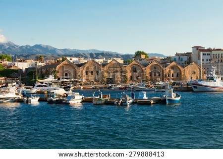 view of harbour with historical houses and boats at sunny summer day in Chania, Crete, Greece - stock photo