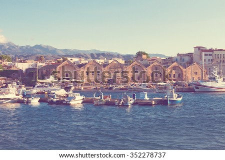 view of harbour with historical houses and boats at sunny summer day in Chania, Crete, Greece, retro toned - stock photo