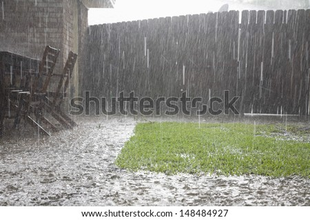 View of heavy rains in backyard - stock photo